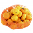 Stock Photo: A bunch of oranges packaged in netting, isolated on white