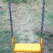 Yellow garden swing hanging — Stock Photo