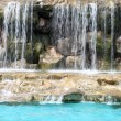Stock Photo: Flowing waterfall in swimming pool