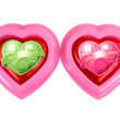 Stock Photo: Wrapped red chocolate hearts on white background