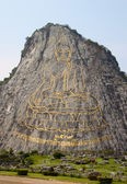 130 mtr high golden Buddha laser carved and inlayed with gold on — Stock Photo