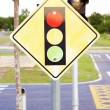 A road sign warning of a traffic light ahead — Stock Photo