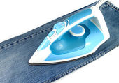 Ironing jeans on a white baclground — Stock Photo