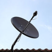 Satellite dish on the roof — Stock Photo