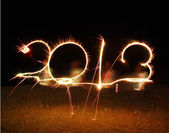 The boy write 2013 new year (fires) — Foto de Stock
