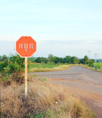 Stop sign in a country road (Thai language) — Stock Photo