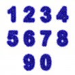 Blue tinsel digits on white — Stock fotografie