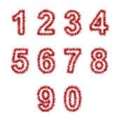 Dígitos oropel rojos sobre fondo blanco — Foto de Stock