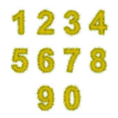 Yellow tinsel digits on white — Stock Photo