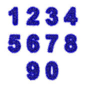 Blue tinsel digits on white — Stock Photo
