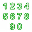 Green tinsel digits on white — 图库照片
