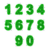 Green tinsel digits with star on white — Stock Photo