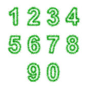 Green tinsel digits on white — Stock Photo