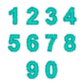Light blue tinsel digits on white — Stock Photo