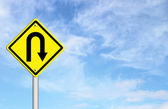 Yellow warning sign u-turn roadsign — Stockfoto