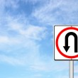 Turn back road sign over blue sky — Stock Photo