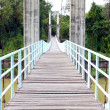 Wooden walkway of the rope bridge — Stock Photo