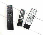 Three remote control on white table — Stock Photo