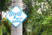 Wi-Fi zone sign on tree — Stock Photo