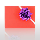 Gift card with violet ribbin bow — Stock Photo