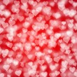Light hearts bokeh as background — Stock Photo