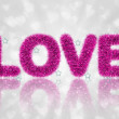 Foto Stock: Text love with tinsel pattern