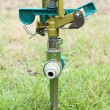 Sprinkler on the green grass — Stock Photo
