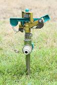 Sprinkler on the green grass — Stock Photo