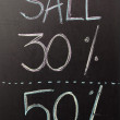 50 discount sign written with chalk — Stock Photo