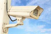 CCTV security camera with blue sky — Stock Photo