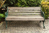 Wooden park bench — Stock Photo