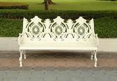 White bench in park — Stock Photo