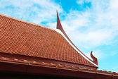 Wooden Thai style roof texture with sky — Stock Photo