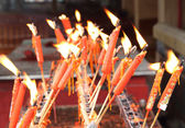 Red chinese candles in temple — Stock Photo