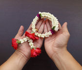 Garland of jasmine flower on hand — Stock Photo