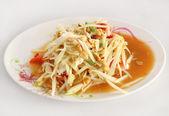 Papaya salad on white table — Stock Photo