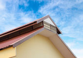 Gable roof against blue sky — Stock Photo