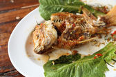 Eaten Fried ruby fish topped with sweet,sauer and hot sauce — Stock Photo