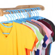 T-shirts hanging on hangers — Stock Photo