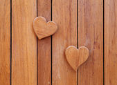 Wooden hearts on wooden background — Stok fotoğraf