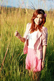 Portrait of beautiful young Asian girl in the grass — Stock Photo