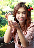 Beautiful asian woman applying make up  — Stock Photo
