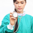 Female doctor wearing a green scrubs and stethoscope — Stock Photo #47811993