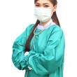 Female doctor wearing a green scrubs and stethoscope — Stock Photo #47812121