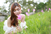 Pretty asian woman in siam tulip flower field — Stock Photo