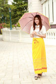 Thai girl dressing and umbrella with traditional style — Stock Photo