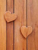 Wooden hearts on wooden background — Foto de Stock