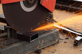 Worker cutting steel rod — Stock Photo