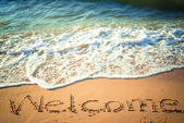 Writing Welcome on the Beach in Thailand — Stock Photo