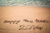 写快乐的元旦 2014 年前在泰国海滩 — 图库照片